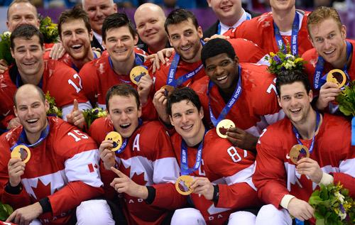 National pride: Canada's men's hockey team celebrate winning the Olympic gold in Sochi. *MCT photo
