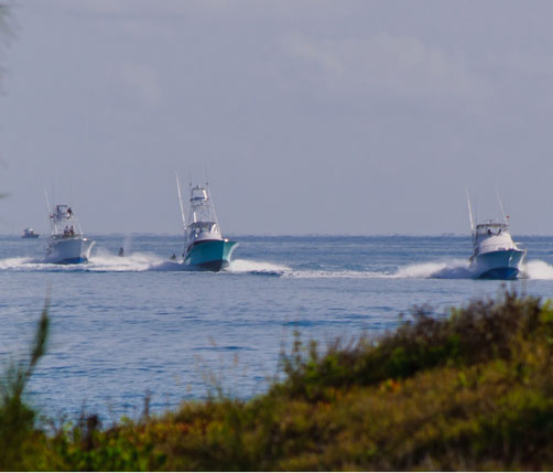 Bermuda boost: Boats hit the water in preparation fir the Bermuda Big Game Classic, which gets under way today. The Bermuda Triple Crown is a huge boost to the island's economy. *Photo by James Simmons: contact jay_tech@yahoo.com