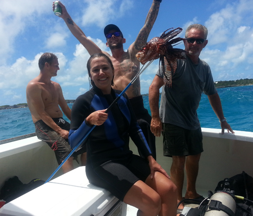 Team Hurdy Gurdy, for which Bermuda Sun reporter Sarah Lagan was a team member, celebrate catching one of the larger fish on the day. *Photo by Sarah Lagan