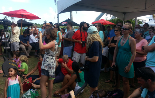 Revellers watch the award ceremony held at the BIOS station yesterday. *Photo by Sarah Lagan